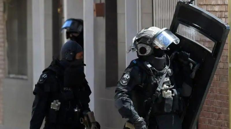 Special police forces leave after searching the apartment of a man who tried to attack a police station in Cornella near the northeastern Spanish city of Barcelona on August 20, 2018. (Photo: AFP)
