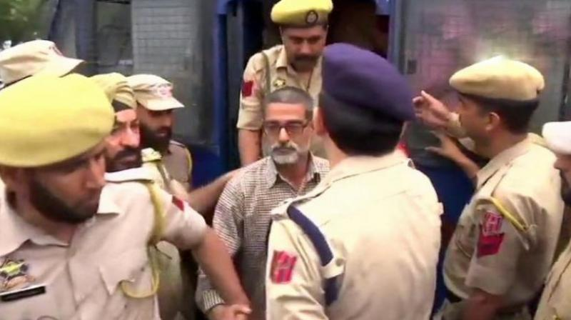 Sanji Ram, the main accused in Kathua rape and murder case, being produced in District Court in Kathua. (Photo: File/ANI)