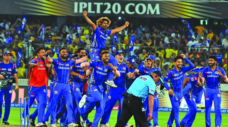 Mumbai Indians carry their last-over hero Lasith Malinga after edging Chennai Super Kings to a thrilling victory in the IPL final. 	(Photo: P. Surendra)