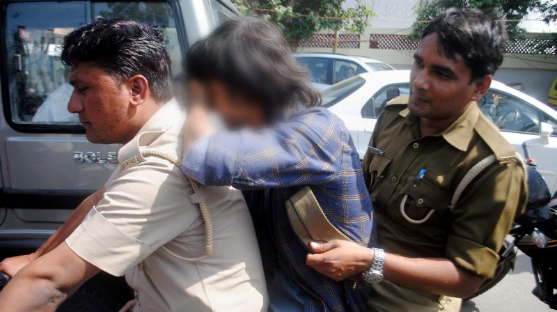 Anti-Romeo squad of police detaining a youth in Lucknow. (Photo: PTI/File)