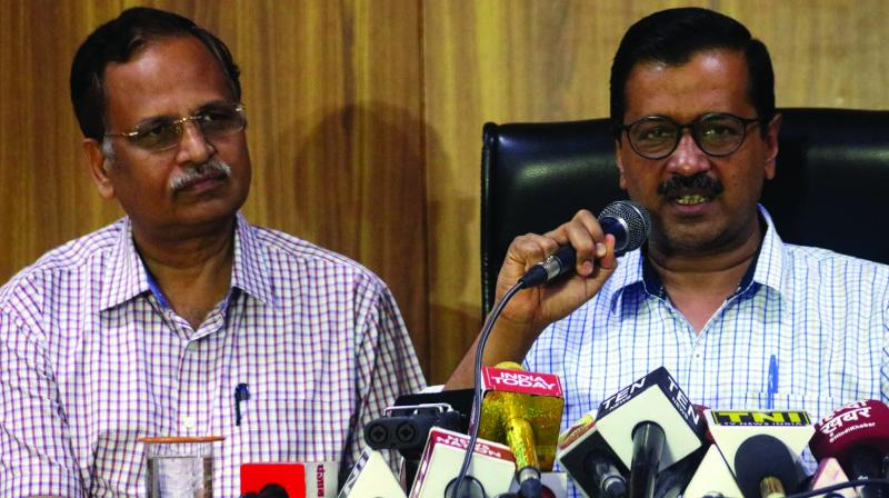 Delhi chief minister Arvind Kejriwal with health minister Satyendar Jain during a press conference on Saturday. (Photo: Bunny Smith)