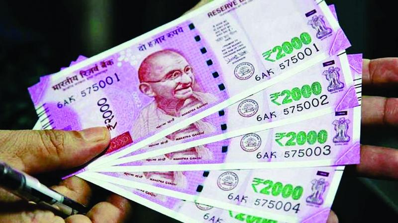 Rupee slips 13 paise against dollar in early trade