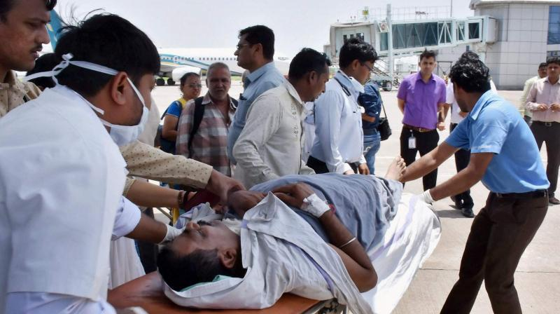 File photo of one of the Amarnath pilgrims, injured in the terror attack in Jammu and Kashmir, after being brought to the Surat airport in an IAF plane. (Photo: PTI)