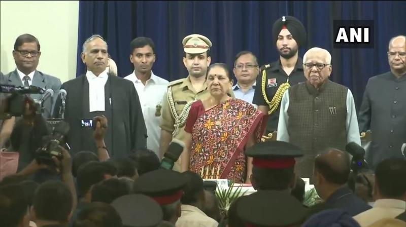 Outgoing Governor Ram Naik also attended Anandiben Patel's swearing-in ceremony. (Photo: ANI)