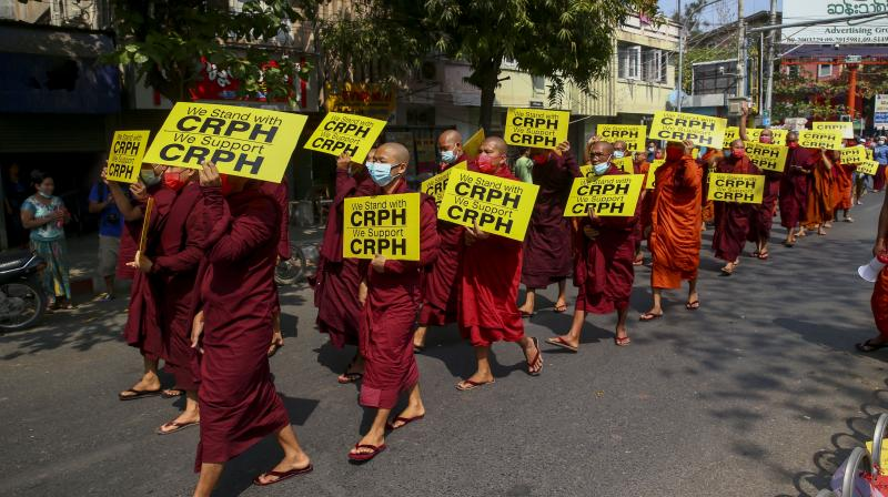 Buddhist monks lead an anti-coup protest march in Mandalay, Myanmar on Feb. 27, 2021. 'CRPH' in the placards stand for 'Committee Representing Pyidaungsu Hluttaw.' (AP)