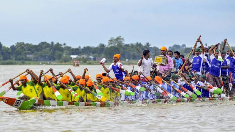 Local fishermen participate in the race. (Photo: PTI)
