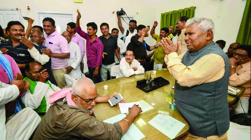 Ticket-seekers and supporters demonstrate in front of RJD Bihar president Ram Chandra Purve inside the party's state head office ahead of the Lok Sabha polls in Patna on Sunday. (Photo: PTI)