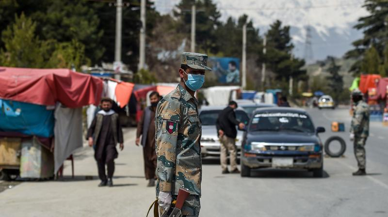File image of an Afghan securityman standing guard on a Kabul road. (AFP)