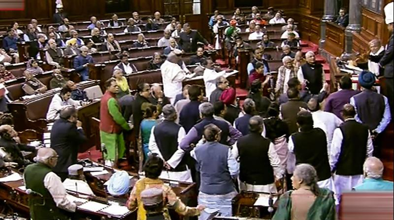 Opposition members protest in Rajya Sabha during Winter Session of Parliament. (Photo: RSTV grab via PTI)