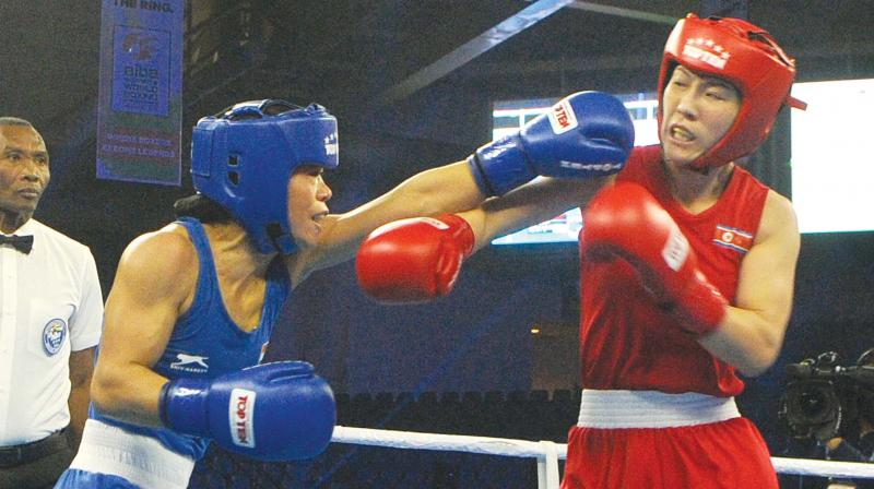 M.C. Mary Kom (left) in action against Kim Hyang Mi of North Korea in their 45-48 kg category semifinal bout at the Aiba Women's World Boxing Championships in New Delhi on Thursday. (Photo: Biplab Banerjee)