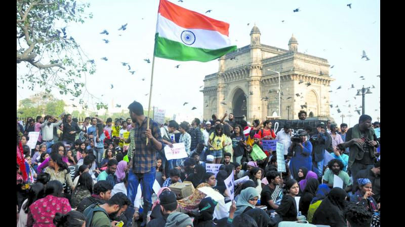 Youths at the Gateway of India to condemn the Jawaharlal Nehru University attack.