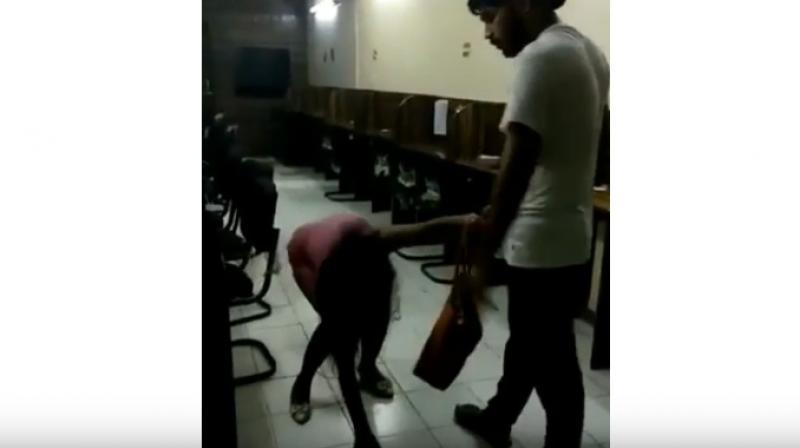 The man identified as Rohit Tomar, is seen brutally thrashing and kicking the woman with his knees and dragging her by her hair as she pleads for mercy.(Photo: YouTube | Screengrab)