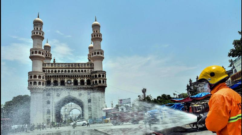 Murshidabad: A Fire Services person sprays disinfectant near the historic Charminar during ongoing COVID-19 lockdown, in Hyderabad, Telangana. PTI Photo