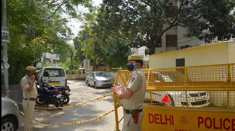 Police personnel stand guard at Model Town police colony, identified as a COVID-19 hotspot, during the nationwide lockdown to curb the spread of coronavirus, in New Delhi. PTI Photo