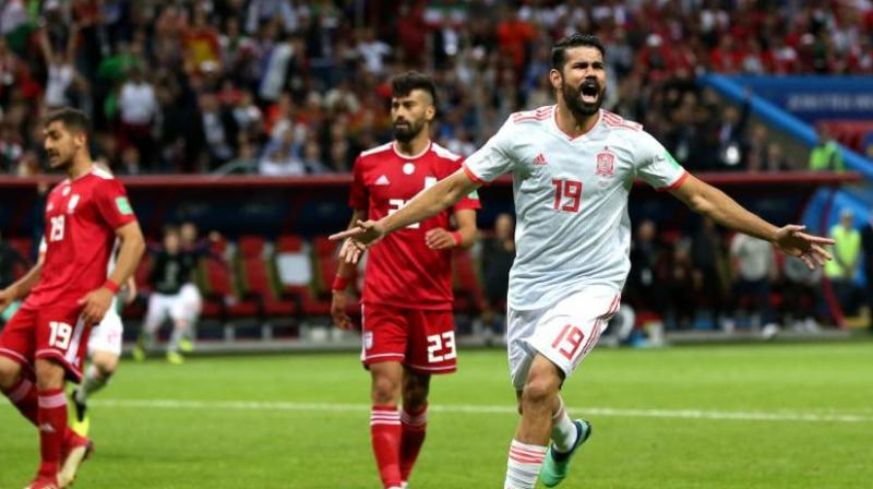 The powerful striker turned in the area and took a shot but the ball deflected off Ramin Rezeian before bouncing back onto Costa's knee and into the net. (Photo: Fifa official site)