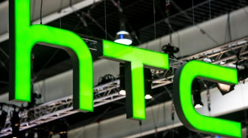 HTC said it would cut 1,500 jobs in its manufacturing unit in Taiwan.