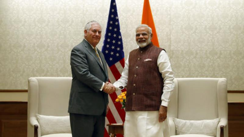 US secretary of state Rex Tillerson, left, shakes hands with Prime Minister Narendra Modi before their meeting at the Prime Minister's residence in New Delhi earlier this week. (Photo: AP)