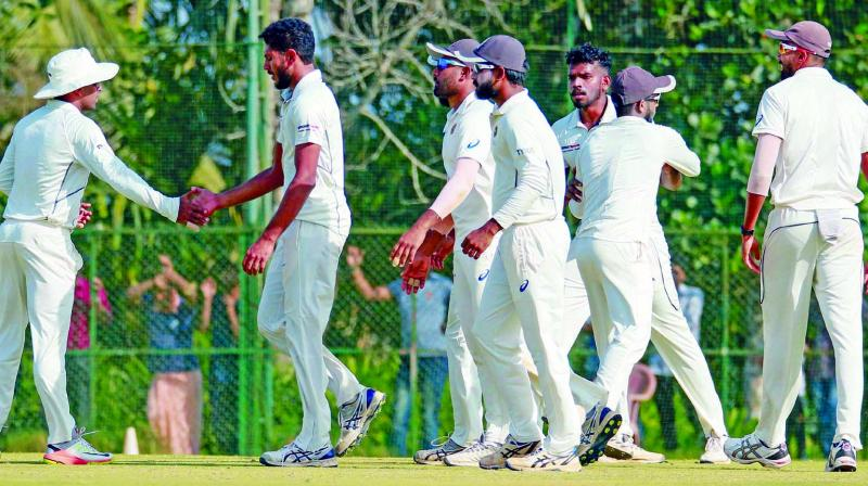 Kerala players celebrate a Gujarat wicket during the quarterfinal at Wayanad. (Photo: PTI)