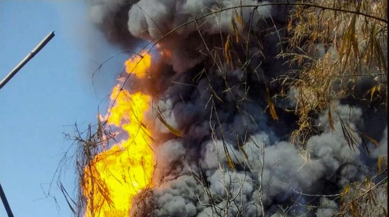 Smoke billows from a fire at Baghjan oil field, a week after a blowout in TInsukia, Assam. PTI photo
