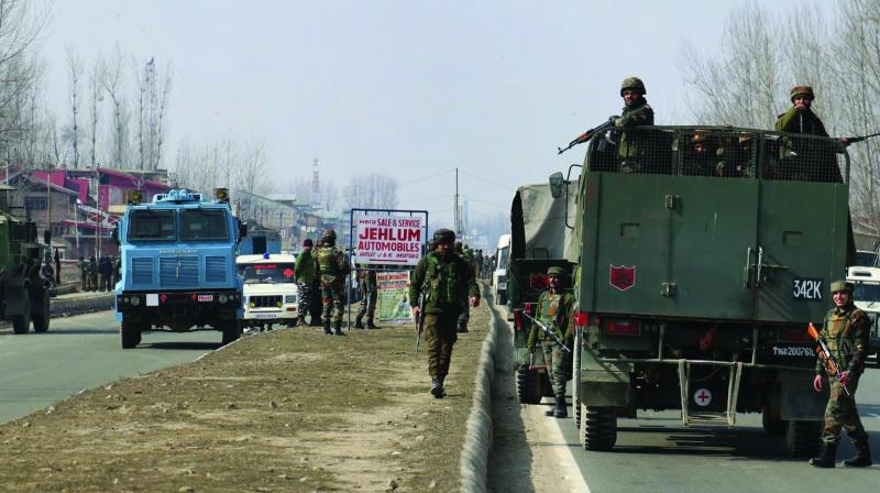 Security forces at the shootout scene at Lawaypora, near Srinagar, on Wednesday. (Photo: HU. Naqash)