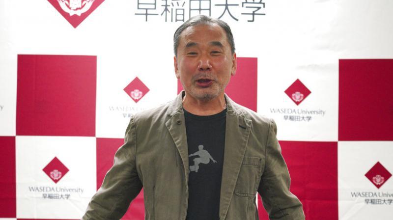 Japanese novelist Haruki Murakami poses for photographers during a press conference at Waseda University in Tokyo. (Photo: AP)