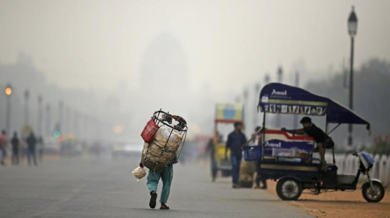 As cooler air traps pollutants close to the ground, Delhi's levels of PM2.5 -- particles so tiny they can enter the lungs and bloodstream -- often soar to beyond 30 times the safe limit. (Photo: AP)