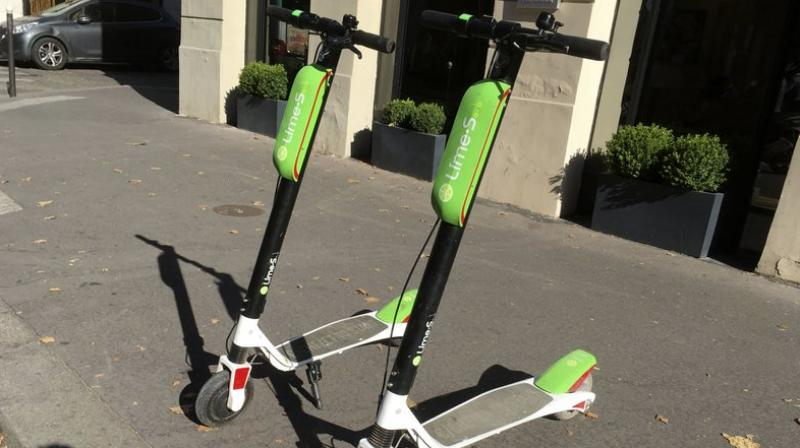 Customers will be able to rent Lime scooters in more than 70 locations in the US and Europe and leave them parked for the next customer to ride. (Photo: AP)