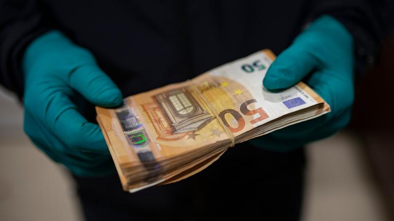 Experiments done at 20, 30 and 40 degrees C showed the virus survived longer at cooler temperatures, longer on smooth surfaces than on complex surfaces such as cotton, and longer on paper banknotes than on plastic banknotes. (Representational Image:AFP)