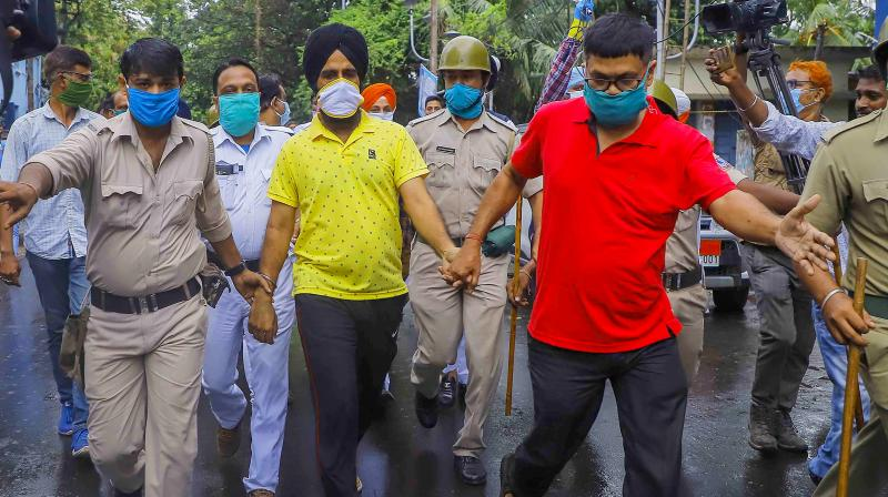 Balwinder Singh, a Sikh man whose turban was allegedly pulled by the police and later detained during recent protest rally, arrives to appear in a court, in Howrah district, Sunday, Oct. 11, 2020. The police, however, argued that the man was carrying a firearm and that his headgear