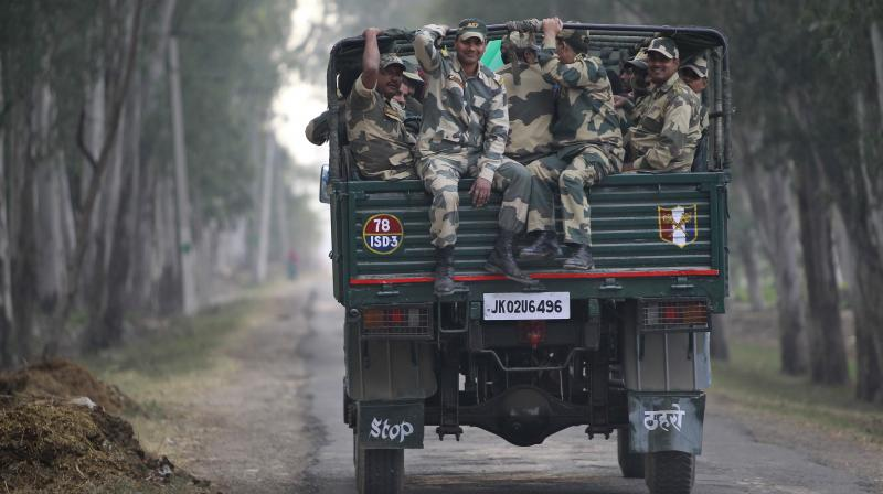 Indian Border Security Force soldiers travel on a truck to be deputed for night patrol duty along the India-Pakistan international border in Ranbir Singh Pura, about 25 kilometers from Jammu, India. (Photo: AP)