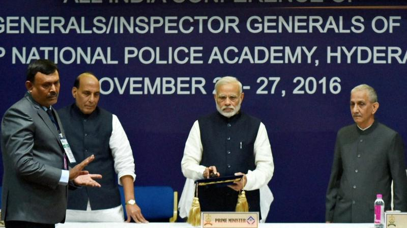 Prime Minister, Narendra Modi with Union Home Minister, Rajnath Singh launching the mobile app - Indian Police at Your Call, at Annual Conference of DGs/IGs of Police, in Hyderabad. (Photo: PTI)