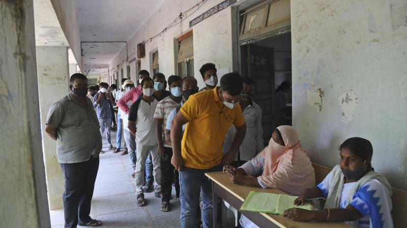 People enroll their names to be administered the Covaxin COVID-19 vaccine during a special vaccination drive at Shadnagar, about 45 kilometers from Hyderabad. (Photo: PTI)