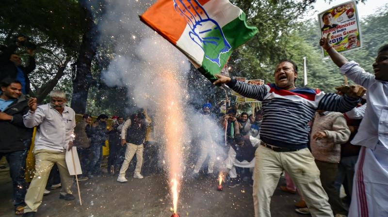 Congress Party workers celebrate the party victory in the states Assembly elections, at the Congress headquarters in New Delhi. (Photo: PTI)