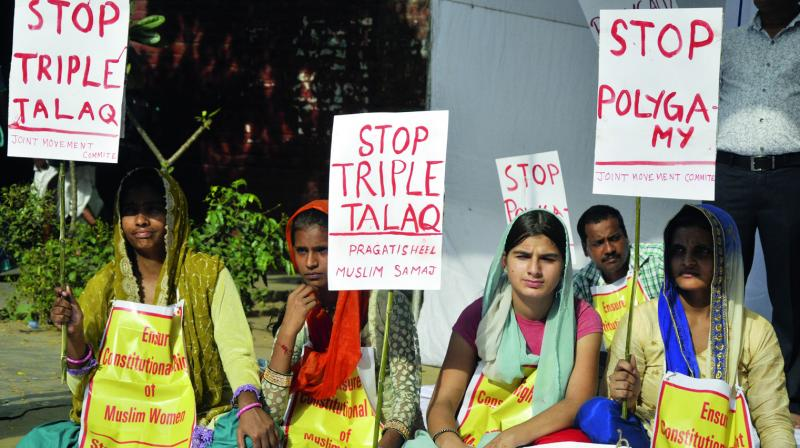 Women hold placards during a protest against triple talaq in New Delhi. (Photo: Bunny Smith)