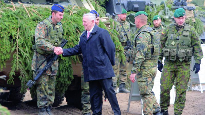 US defence secretary James Mattis shakes hands with a German soldier as he meets with US troops deployed in Lithuania, with representatives of the Lithuanian Armed Forces and soldiers of the Nato-enhanced Forward Presence Battalion Battlegroup in Lithuania, in Pabrade. (Photo: AP)