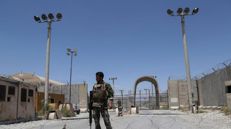 An Afghan National Army (ANA) soldier stands guard at Bagram Air Base, after all US and NATO troops left, some 70 Km north of Kabul. (Photo: AFP)
