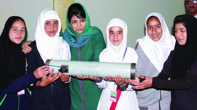 A file photo of PDP chief Mehbooba Mufti interacting with students during an event in Jammu and Kashmir
