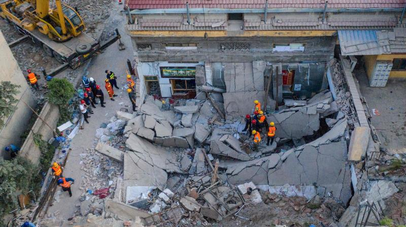 Rescuers searching through the rubble of a collapsed restaurant in Linfen, in China's northern Shanxi province. (AFP)