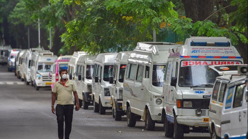 Ambulances lined up on JC Road in Bengaluru amid total lockdown. PTI photo