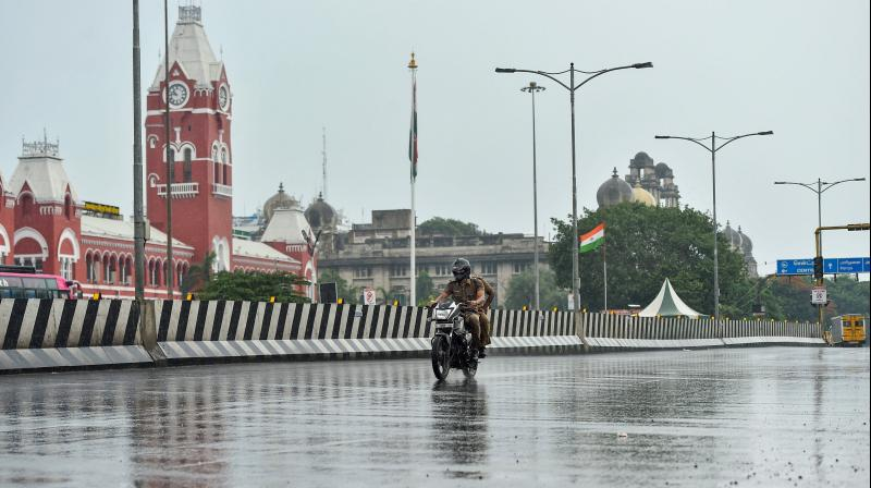 A scooter plies on an empty road during an intensive lockdown imposed to curb spread of covid19 in Chennai, Tamil Nadu. PTI photo
