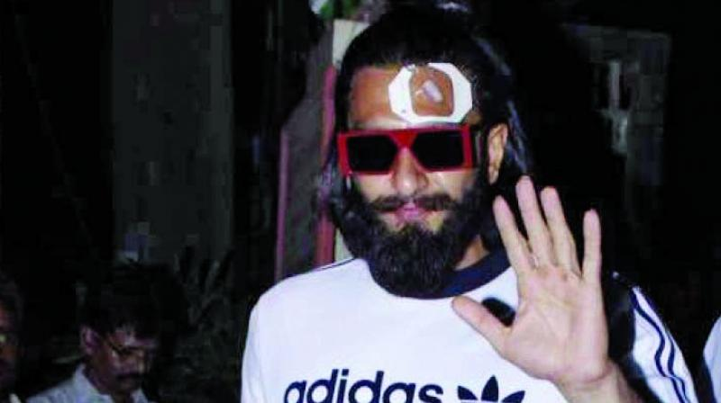 Back in action: Ranveer Singh exiting Lilavati hospital after being treated.