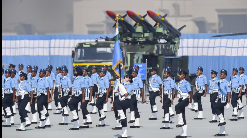 IAF personnel march past during the 88th Air Force Day celebrations at Hindon airbase in Ghaziabad. — PTI photo