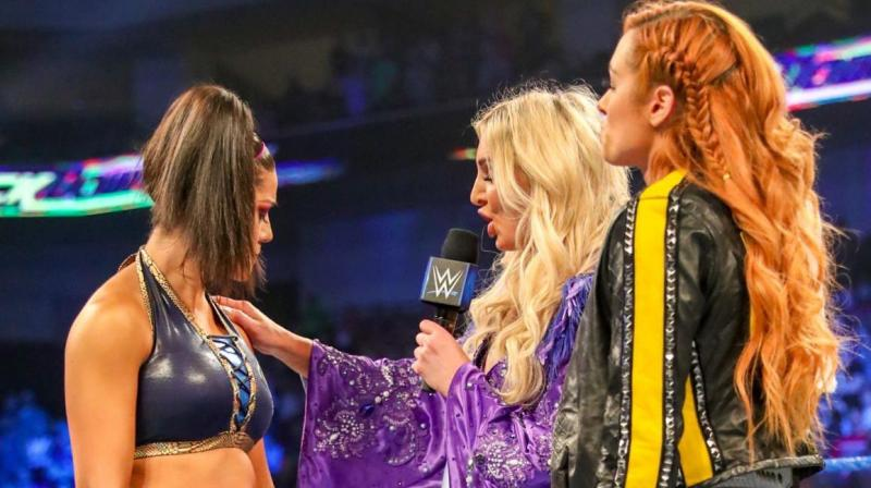 Lynch has been straight to the point that for a long time she had been living under the shadows of the former eight time champion, Charlotte Flair.  But now since Lynch is out of Flair's shadow, she is now planning to look forward, and be focused on defending her Raw and Smackdown title. (Photo: Bayley/ Twitter)