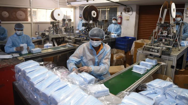 Indian manufacturers of masks and gloves are very upset that no import duty will be levied on these items. (AFP Photo)