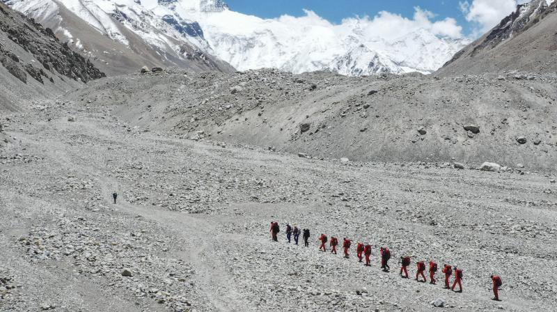 In Nepal, several climbers have reported testing positive for COVID-19 after they were brought down from the Everest base camp. (AP Image)