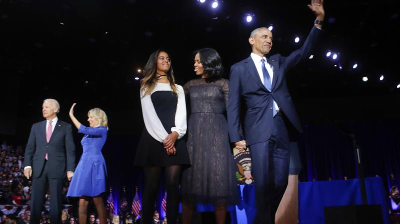President Barack Obama on stage with first lady Michelle Obama, daughter Malia, Vice President Joe Biden and his wife Jill Biden after his farewell address at McCormick Place in Chicago. (Photo: AP)