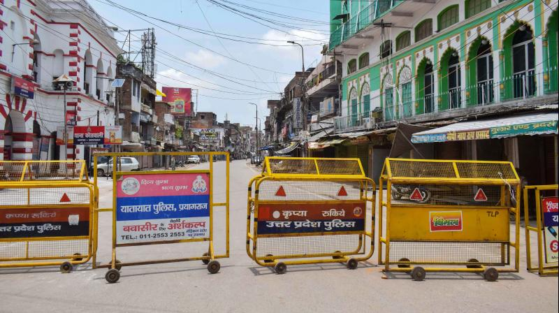 A closed road during the lockdown announced by the state government to curb the spread of virus in Prayagraj. PTI photo