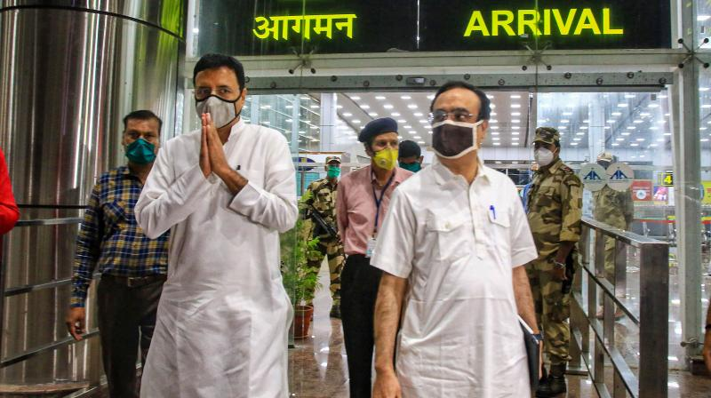 Senior congress leader Randeep Surjewala and Ajay Maken arriving at Jaipur airport. PTI photo