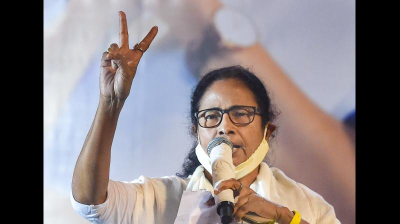 TMC supremo and West Bengal Chief Minister Mamata Banerjee flashes the victory sign during interaction with media after trends show her party's wins in the State Assembly Election 2021, in Kolkata, Sunday, May 2, 2021. (PTI)