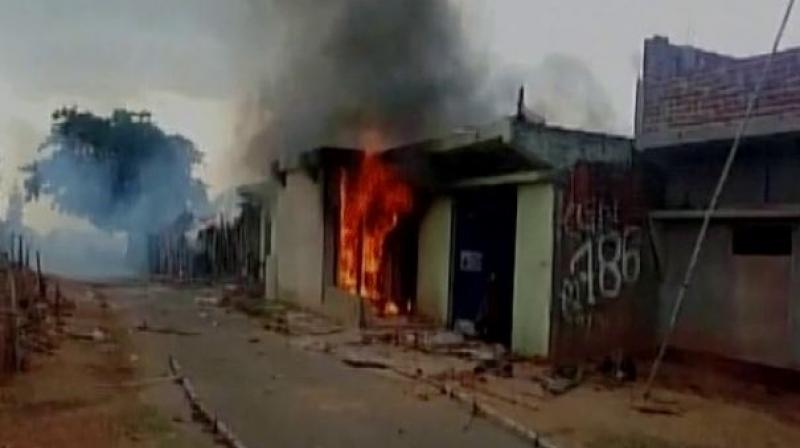 Police had to open fire in the air to disperse the stone pelting crowd. (Photo: ANI | Twitter)